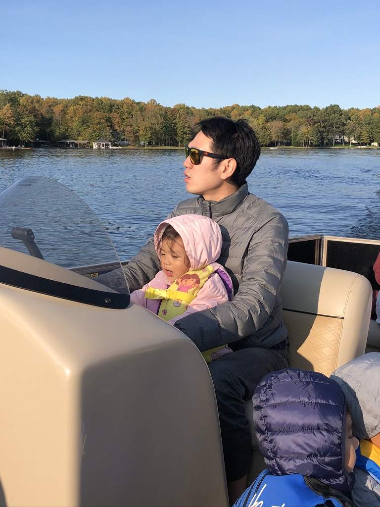 Avery and Daddy driving the boat